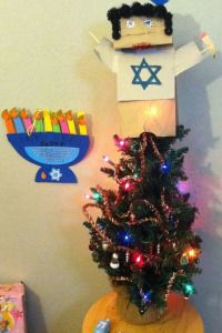 Hanukkah Bush: The author explains how he was forced to cave in and accept a Christmas tree in his Jewish home.