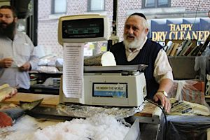 Schlomo Raskin stands behind the counter at his fish shop which has been serving Brooklyn for more than 50 years.