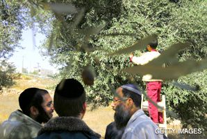STANDING BY: In a more peaceful moment, Jewish settlers in the