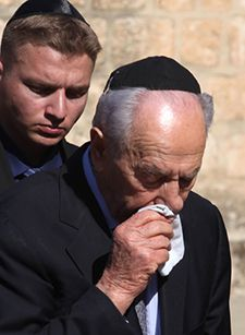 Bereaved: Shimon Peres in tears at Sonia?s funeral.