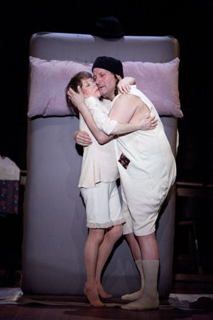 In Bed together: Shlemiel (Michael Ianucci) and his wife, Tryna Ritza (Alice Playten), play dumb and act smart.