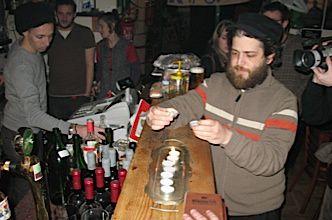 Lighting a makeshift menorah set up on the bar during Hanukkah.