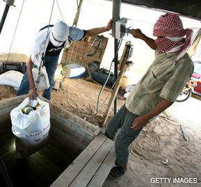UNDERGROUND COMMERCE: A Palestinian in Gaza pulls up smuggled goods from Egypt, transported via a tunnel into Rafah refugee camp on the border. Other tunnels, dug by Hamas and targeted by Israel, are used to transport arms.