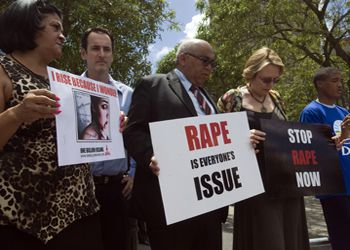 Western Cape Province Premier and leader of the opposition Democratic Alliance (DA) party Helen Zille (2nd R) joins a protest against rape on February 11, 2013 outside the parliament in the center of Cape Town.