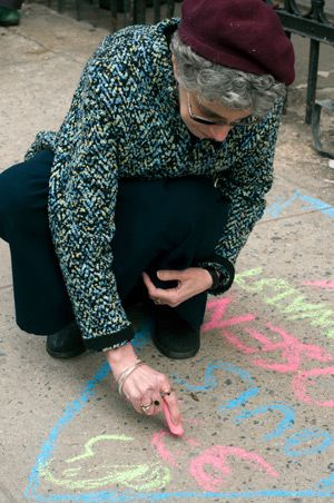 In Memory: Esther Malka Boyarin memorializes a Triangle fire victim in front of the Stanton Street Shul.