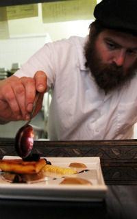 Deliciously Kosher: Moshe Wendel puts the finishing touches on a dish at Pardes, his restaurant in Brooklyn.