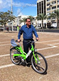 Getting There: Tel Aviv?s mayor, Ron Huldai, poses with one of the new bicycles that will be available for rent.