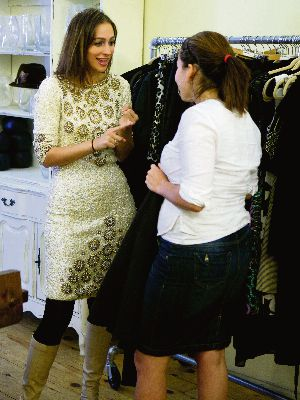 Shopping Spree: Lakey Nemes (left) tries on a sequined dress at the Frock Swap. She didn?t buy it because it wasn?t modest enough.