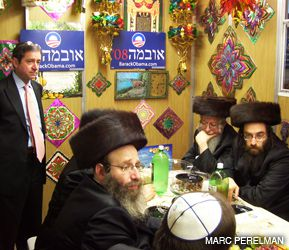 CAMPAIGN EVENT: Hasidim gathered in a Brooklyn Sukkah to hear Obama surrogates speak about the candidate.