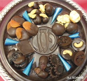 CONFECTIONS: Sweethearts Three offers a kosher for Passover chocolate Seder plate.