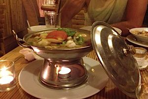 Bayt Thailandi serves up more than your standard pad Thai and curries. Here diners dig into a giant pot of tom yum soup.