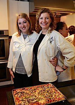 First place winners Tanya Gurovich and Natalia Karpov stand by their cauliflower pizza.