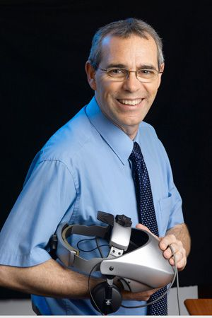 Unpredictable: David Passig (holding a virtual reality helmet used in his labo- ratory) is one of a handful of futurists in Israel.