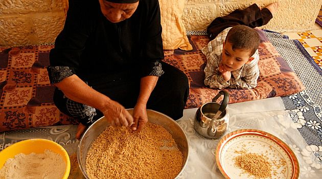 Cuisine of a People: Siham Khaled Mustafa rolling maftoul, or Palestinian couscous, at her home in the village of Dayr Balut.