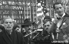 STANDING WITH ISRAEL: Representative Anthony Weiner speaks as Assemblyman Dov Hikind and Councilman David Weprin look on at a pro-Israel rally January 5 arranged by Rambam Mesivta High School outside the United Nations.