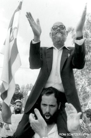 West Bank: Rabbi Moshe Levinger, a religious Zionist, was a leading figure in the settler movement after the Six Day War, spearheading Jewish settlement in Hebron and playing a large role in Gush Emunim. Above, supporters carry Levinger away from the gates of Eyal prison following his release in 1990. He had been imprisoned for three months for killing an Arab shopkeeper in Hebron.