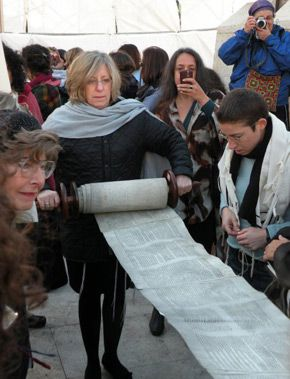 Illegal Prayer: Nofrat Frenkel (right), the author, reading from the Torah.