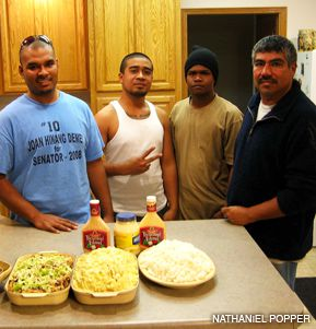 FINDING REFUGE: Three workers who came from Palau, from left, Rayvan Adelbai, Nicholson Nichola, and Pollan Paulino have been given a place to stay at the home of Elmer Herrera, right, as the kosher meat packer Agriprocessors has shed its workforce.