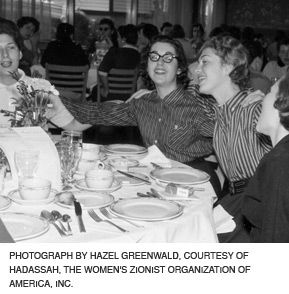 THE YOUTH GROUP THAT SINGS TOGETHER, STAYS TOGETHER: Teen girls of Junior Hadassah sing around the table at the 1958 convention.